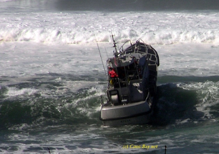 coast guard riding waves
