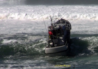 coast guard riding waves